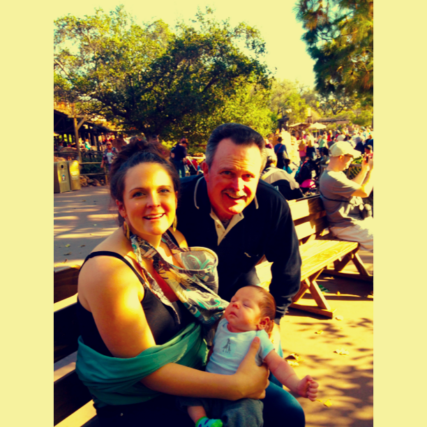 My dad, Luca and I on a bench by the Rivers of America. This was a nice secluded place to nurse using the nursing cover. There was also a Child Center located off of Main Street (by the Corn Dog stand- how convenient!). It had a nursing center and changing station.