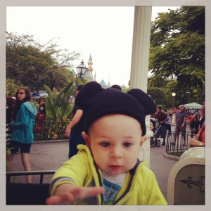 Luca hanging-out with his Mickey Ears on. Note castle in the background, I worked hard to get this magical moment on camera, people.