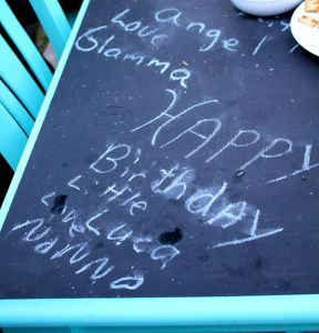 Birthday notes to Luca on our newly painted outdoor table.
